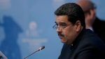 Venezuela's President Nicolas Maduro addresses the Organisation of Islamic Co-operation's Extraordinary Summit in Istanbul, Wednesday, Dec. 13, 2017. (Erhan Elaldi/Pool Photo via AP)