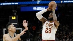 Cleveland Cavaliers forward LeBron James (23) shoots and scores over San Antonio Spurs guard Danny Green (14) during the first half of an NBA basketball game, Tuesday, Jan. 23, 2018, in San Antonio. (AP Photo/Eric Gay)