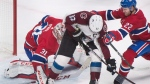 Colorado Avalanche left wing Gabriel Landeskog (92) moves in on Montreal Canadiens goaltender Carey Price (31) as defenceman Karl Alzner (22) defends during second period NHL hockey action in Montreal, Tuesday, January 23, 2018. THE CANADIAN PRESS/Graham Hughes