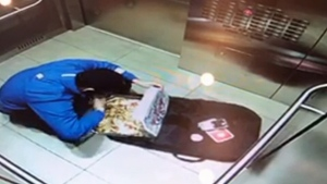 Security footage shows a Domino's delivery driver eating several bits from a pizza as he was taking it to a customer.