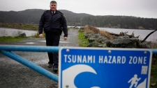 RCMP Chief Supt. Sean Sullivan is the Island District officer in charge of B.C operations and police response to the tsunami warning issued for the west coast of Vancouver Island early Tuesday morning poses for a photograph at Whiffin Spit Park, B.C., on Tuesday, January 23, 2018. THE CANADIAN PRESS/Chad Hipolito