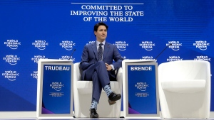 Justin Trudeau, Prime Minister of Canada, sits on the podium prior to his special address on corporate responsibility and the role of women in a changing world during the annual meeting of the World Economic Forum in Davos, Switzerland, Tuesday, Jan. 23, 2018. (AP Photo/Markus Schreiber)