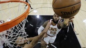 Cleveland Cavaliers forward LeBron James shoots past San Antonio Spurs forward Kyle Anderson during the first half of an NBA basketball game in San Antonio on Tuesday, Jan. 23, 2018. (AP Photo/Eric Gay)