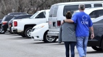 Family members escort their children out of Marshal North Middle School near Palma, Ky. after the students where transported from Marshal High School on Tuesday, Jan. 23, 2018. (AP Photo/Stephen Lance Dennee)