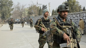 Afghan security forces patrol the site of a deadly suicide attack in Jalalabad, east of Kabul, Afghanistan, Wednesday, Jan. 24, 2018. (AP)