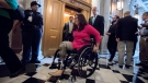 In this Aug. 3, 2017, file photo, Sen. Tammy Duckworth, D-Ill., followed by Sen. Thom Tillis, R-N.C., on Capitol Hill in Washington. (AP Photo/J. Scott Applewhite, File)
