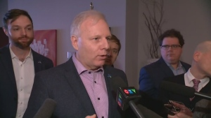 Jean-Francois Lisée speaks to reporters in Shawinigan on Jan. 24, 2018