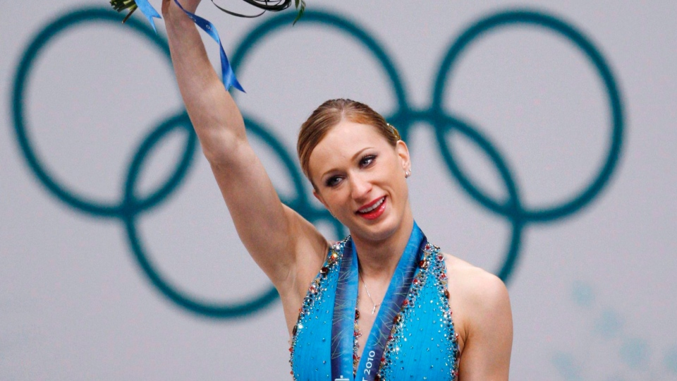 Joannie Rochette holds her flowers after winning a bronze medal in the women's figure skating competition at the 2010 Vancouver Olympic Winter Games in Vancouver on February 25, 2010. (THE CANADIAN PRESS / Robert Skinner)