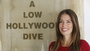 Divorce attorney Laura Wasser, who has represented celebrities like Britney Spears and Johnny Depp, poses at her Century City office in Los Angeles on Jan. 12, 2018. (AP Photo/Damian Dovarganes)