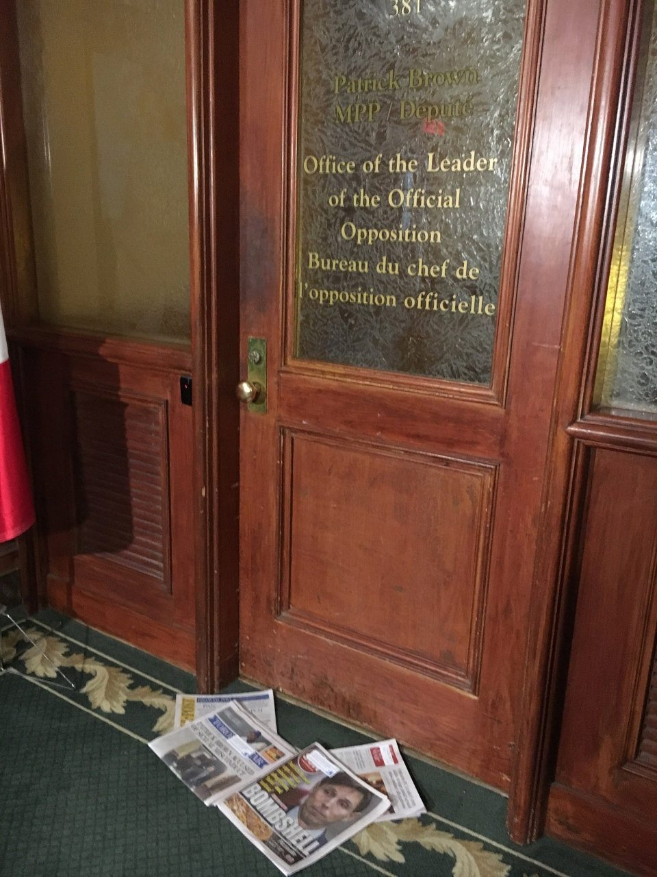 Newspapers sit outside the Office of the Leader of the Official Opposition, the morning after Patrick Brown resigned as Ontario PC Party leader, Thursday, Jan. 25, 2018.