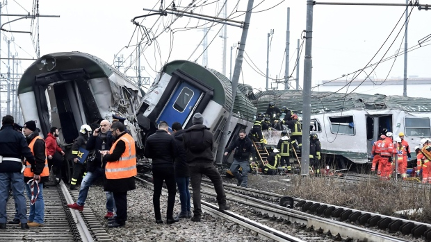 Rescue teams help passenger out of a derailed train at the station of Pioltello Limito, on the outskirts of Milan, Italy, Thursday, Jan. 25, 2018. (Flavio Loscalzo / ANSA via AP)