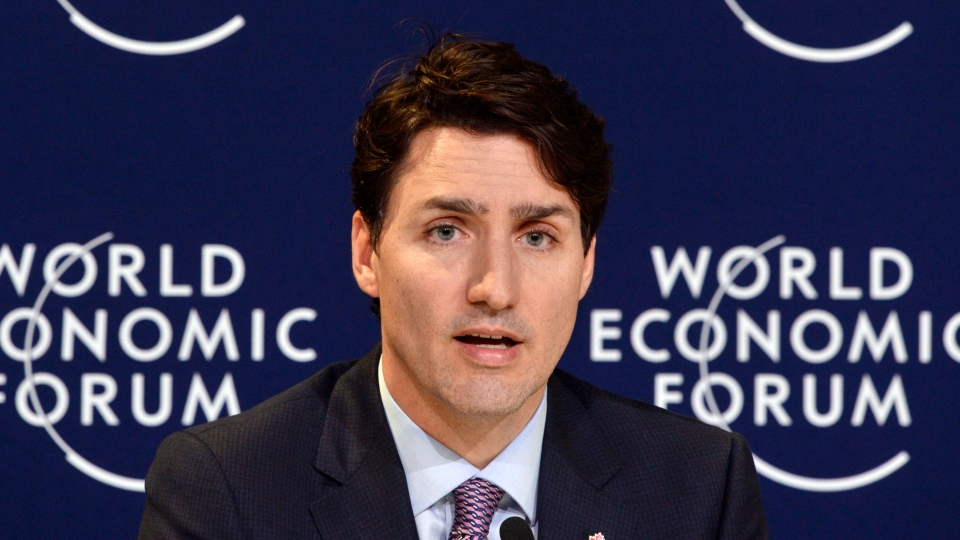 Prime Minister Justin Trudeau speaks to members of the media at the World Economic Forum Thursday, Jan. 25, 2018 in Davos, Switzerland. (THE CANADIAN PRESS/Paul Chiasson)