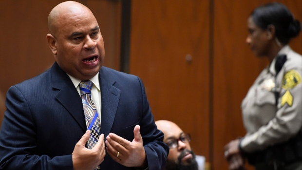 "Attorney Matthew Fletcher, left, speaks for his client, Marion ""Suge"" Knight, right, in a court appearance for a bail review hearing in his murder case in Los Angeles in this file photo from March 20, 2015. Authorities say the high-profile Los Angeles attorney, Fletcher, has been arrested.(File/AP photo)"