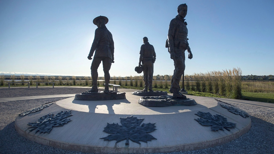 The monument in Moncton, N.B., honouring RCMP Constables Fabrice Gevaudan, Dave Ross and Doug Larche on Sept. 29, 2017. (Andrew Vaughan / THE CANADIAN PRESS)