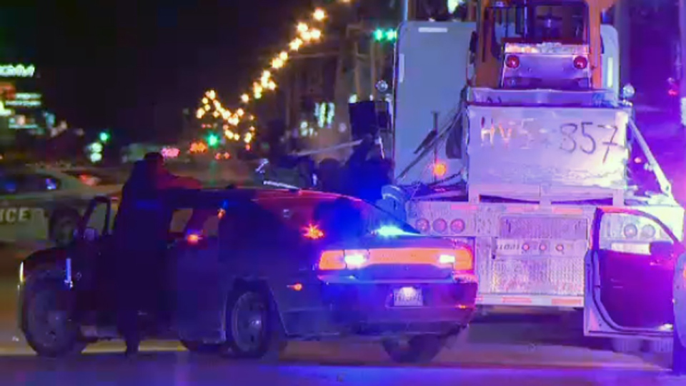 One police officer smashed a window with a piece of lumber while another discharged a fire extinguisher into the cab of a truck, and others held a shield, to force a truck driver to leave his vehicle on Jan. 26, 2018