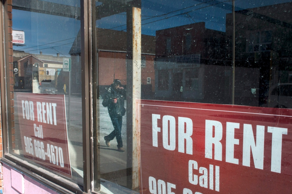 A man is reflected in the windows of a closed store in Oshawa, Ont., Wednesday, Jan. 24, 2018. (THE CANADIAN PRESS / Staff)