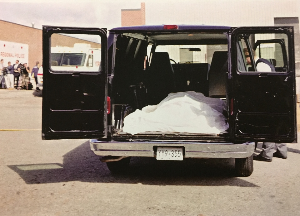 Photo from 1994 crime scene where Melonie's body was found in a burning suitcase