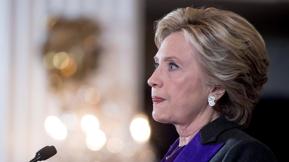In this Nov. 9, 2016, file photo, Hillary Clinton pauses while delivering a speech conceding her defeat to Republican Donald Trump after the hard-fought presidential election. (AP Photo/Andrew Harnik)