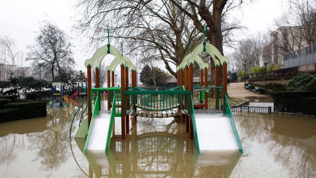 A children's playground is flooded alongside the river Seine in Paris. Floodwaters were nearing their peak in Paris with the rain-swollen Seine River engulfing scenic quays and threatening wine cellars and museum basements. (AP Photo / Thibault Camus)