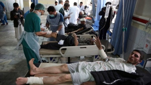 Afghan Injured men receives a treatment at a hospital after a suicide attack in Kabul, Afghanistan, Saturday Jan. 27, 2018. Authorities say suicide car bomber killed dozens of people and wounded over 100 in an attack claimed by the Taliban in the Afghan capital Kabul, authorities said. (AP Photo/ Rahmat Gul)
