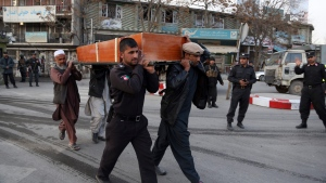 Four men carry the coffin of a man who died in a deadly suicide attack in Kabul, Afghanistan, Saturday Jan. 27, 2018. (AP Photo/Rahmat Gul)