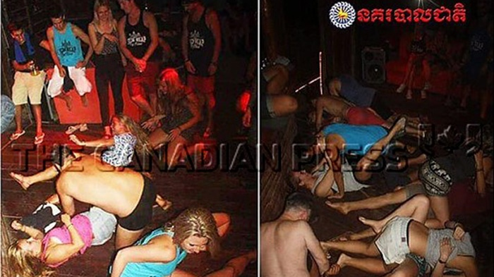 "In this photo dated Jan. 25, 2018, issued by Cambodian National Police, a group of unidentified foreigners, who are accused of ""dancing pornographically"" at a party in Siem Reap town, near the country's famed Angkor Wat temple complex.(Cambodian National Police via AP)"