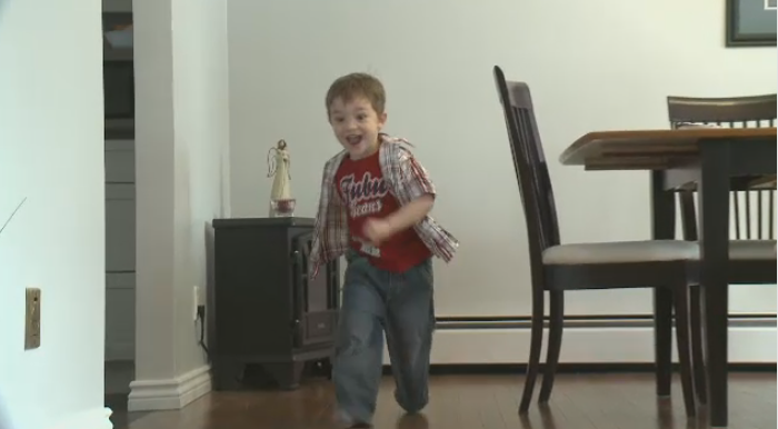 Benjamin Yanko, who was was diagnosed with Systematic Juvenile Idiopathic Arthritis, runs around his house.