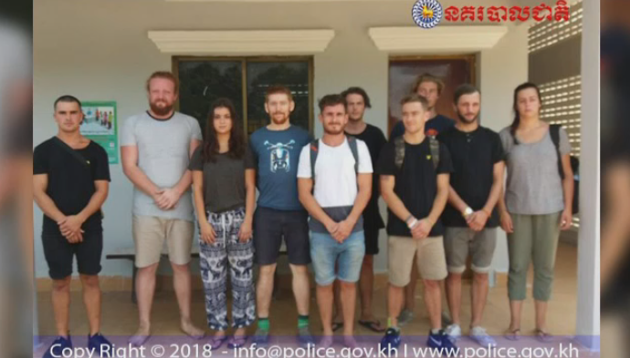 This photo released by Cambodian police shows ten tourists, including 20-year-old Eden Kazoleas of Drayton Valley, Alta. (third from left), after their arrest on Thursday. (General Commissariat of National Police)