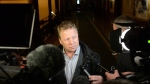 Rick Dykstra is surrounded by reporters in Toronto, on Friday, January 26, 2018. (THE CANADIAN PRESS/Nathan Denette)