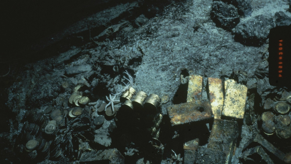 Gold bars and coins from the S.S. Central America, a mail steamship, sunk in a hurricane in 1857, are seen off the North Carolina coast in 1989. (AP Photo, File)