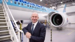 Bombardier president and CEO Alain Bellemare is seen next to a CSeries CS300 ready for delivery to Korean Air Thursday, December 21, 2017 in Mirabel, Que. (Paul Chiasson/THE CANADIAN PRESS)