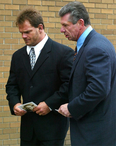 Wrestler Chris Benoit is accompanied by World Wreslting Entertainment Chairman Vince McMahon, to a memorial service for wrestling legend Stu Hart in this Thursday, October 23, 2003 file photo. (CP / Adrian Wyld)