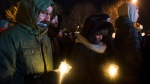 People hold candles at a vigil to commemorate the one-year anniversary of the Quebec City mosque shooting, in Quebec City, Monday, Jan. 29, 2018. THE CANADIAN PRESS/Jacques Boissinot