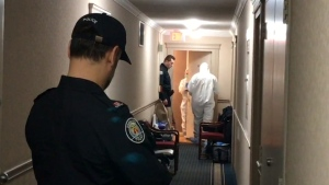 Officers stand in the hallway outside alleged serial killer Bruce McArthur's apartment in January 2018. (CP24)