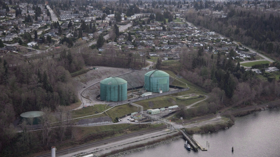 Kinder Morgan Trans Mountain Expansion Project's Westeridge loading dock, at centre with green tanks, is seen in Burnaby, B.C., on November 25, 2016. (THE CANADIAN PRESS/Jonathan Hayward)