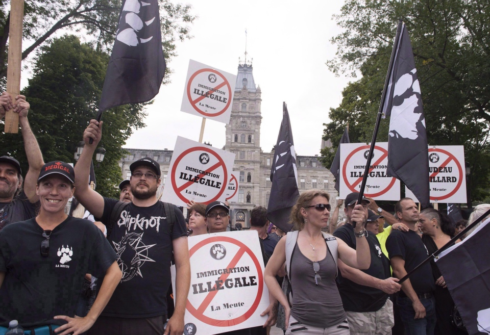 "Demonstrators of a right wing group, ""La Meute"" demonstrate in silence in front of the legislature, Sunday, August 20, 2017 in Quebec City. (Jacques Boissinot/THE CANADIAN PRESS)"