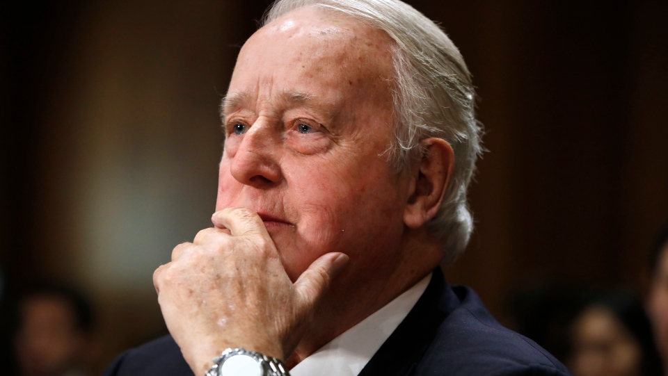 Brian Mulroney, the former prime minister of Canada, right, listens during a Senate Foreign Relations Committee hearing on the Canada-U.S.-Mexico relationship, Tuesday, Jan. 30, 2018, on Capitol Hill in Washington. (AP Photo/Jacquelyn Martin)