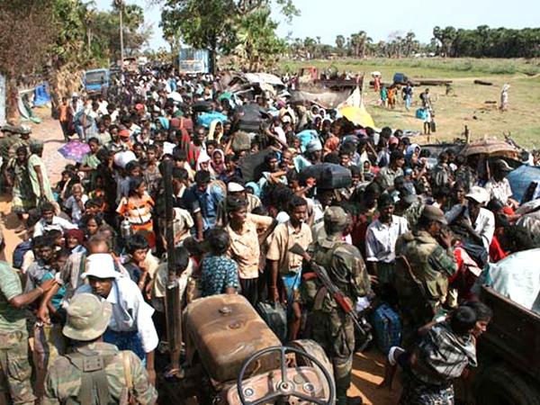 In this handout photo provided by the Sri Lanka Army, Sri Lankan army soldiers receive internally displaced ethnic Tamil civilians in Kariyalamullivaikal, Sri Lanka, on Saturday, May 16, 2009. (AP / Sri Lanka Army, HO)