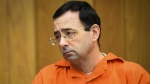 Larry Nassar listens to 17-year-old Jessica Thomashow's victim impact statement Wednesday, Jan. 31, 2018, during the first day of victim impact statements in Eaton County Circuit Court in Charlotte, Mich.(Matthew Dae Smith/Lansing State Journal via AP)