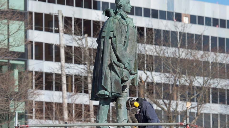 A worker prepares to remove the statue of Edward Cornwallis, a controversial historical figure, in a city park in Halifax on Wednesday, Jan. 31, 2018. Cornwallis, the military officer who founded Halifax in 1749, offered a cash bounty to anyone who killed a Mi'kmaw person. THE CANADIAN PRESS/Andrew Vaughan