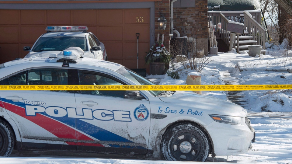 Police stand guard at a house on Mallory Crescent in Toronto on Tuesday, January 30, 2018. Police are investigating the property in relation to the murder charges laid against Bruce McArthur. THE CANADIAN PRESS/Frank Gunn