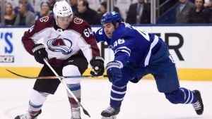 Colorado Avalanche right wing Nail Yakupov (64) plays the puck in the offensive zone as Toronto Maple Leafs defenceman Roman Polak (46) defends during first period NHL hockey action in Toronto on Monday, January 22, 2018. (THE CANADIAN PRESS/Nathan Denette)