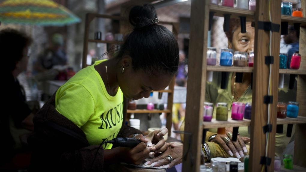 Private manicurist at work in Havana, Cuba