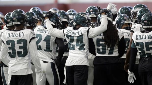 Philadelphia Eagles huddle during a practice