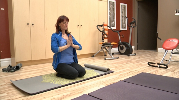 Heart attack survivor Jo-Anne Swanson doing yoga.