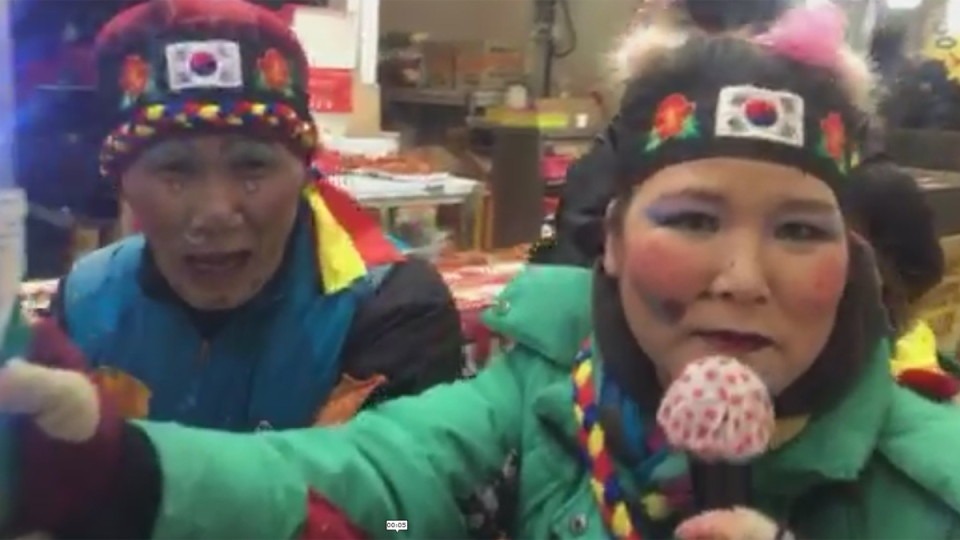 Getting in the spirit at a market near the Olympic Oval and Ice Arena in Gangneung, South Korea. (CTV News / Genevieve Beauchemin)