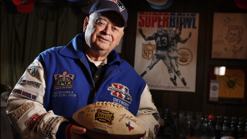 Donald Crisman with memorabilia from 51 Super Bowls at his home in Kennebunk, Maine. (Robert F. Bukaty / AP)