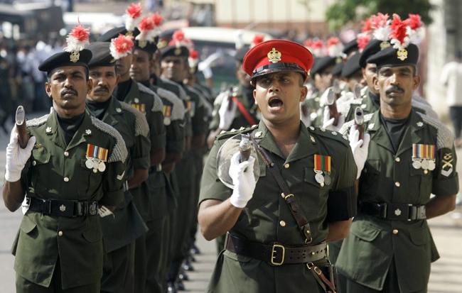 Sri Lankan army soldiers march during the funeral of Lance Corporal Roshan Pradeep Rodrigo in Colombo, Sri Lanka, Saturday, May 16, 2009. Rodrigo died last week in the clashes between Tamil Tiger rebels and Sri Lankan security forces in north eastern Sri Lanka. (AP / Eranga Jayawardena)