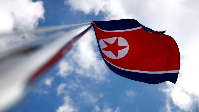 The North Korean flag flies amongst flags from many nations participating in the 2018 Winter Olympics at the Pyeongchang Olympic Village in Pyeongchang, South Korea, Friday, Feb. 2, 2018. (AP Photo/Patrick Semansky)