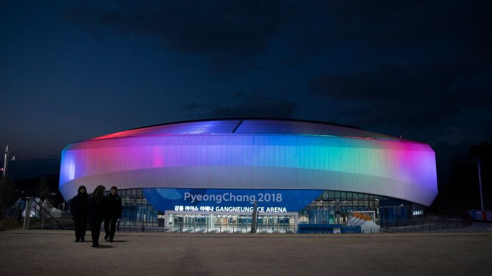 The Gangneung Ice Arena is illuminated at night during a Men's Short Track Speed Skating training session ahead of the 2018 Winter Olympics in Gangneung, South Korea, on Friday, Feb. 2, 2018. (AP Photo/Felipe Dana)